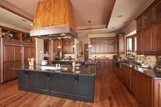 I like the way the different wood species and colors come together in this kitchen by Lifestyle Kitchen & Bath Center in Parker, CO