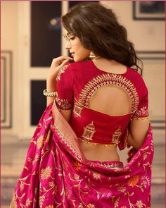 blouse designs Make a Luxurious statement with this gorgeous Golden and Ruby Red Silk Lehenga Choli. The Lehenga Set is beautifully weaved together with Stonework and Heavy Embroidery. Indian Blouse Designs, Choli Blouse Design, Wedding Saree Blouse Designs, Saree Blouse Neck Designs, Fancy Blouse Designs, Wedding Sarees, Latest Blouse Designs, Golden Blouse Designs, Pattern Blouses For Sarees