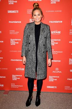 Pregnant Chrissy Teigen is our winter style crush in this black-and-white coat at the Sundance Film Festival on Sunday, Jan. Cold Weather Outfits, Winter Outfits, Celebrity Outfits, Celebrity Style, Chrissy Teigen Style, Sports Illustrated Swimsuit Covers, Cutout Boots, Blazers, Sundance Film Festival