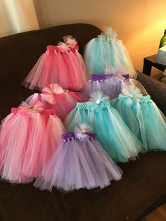Tutus with matching hair bows for the little girls at the party❤️