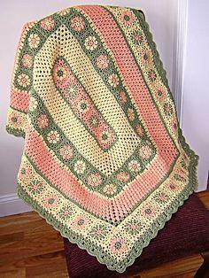 manta  a crochet  rosa ploma y blanca