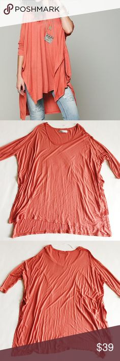 "Free People Big Dipper Top Free People Big Dipper Top in terra cotta, a dark coral pink.  Oversized with deep side slits.  Dropped shoulders and hi-low hem.  Pre-loved but in excellent condition.  Minor signs of normal wash and wear.  Stock photos in other colors, show multiple ways to style.  Size XS.  Could fit XS-M.  Please verify measurements.   Measurements laying flat: Armpit to armpit: 28.5"" Waist (across): 27"" Total length: 32.5"" Sleeve length: 18"" Free People Tops"