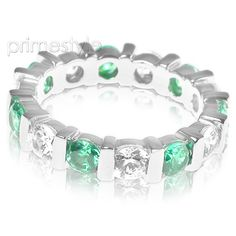 Present yourself with our luxuriant 18KT white gold diamonds and emeralds eternity band. Composed with 3.20CT round cut breathtaking diamonds and emeralds . This eternity band features exquisite diamonds of I-J color and, VS2-SI1 group clarity. Shine with elegance and simplicity with our 18KT white gold diamonds and emeralds eternity band.