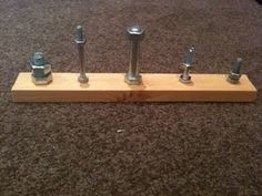 nuts n bolts board - perfect for fine motor skills, and hand eye coordination. You could fit this in a busy bag, and it's perfect for my boys! One more thing to add to my husband's to do list.
