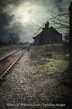 Trevillion Images - abandoned-station-with-railway-tracks