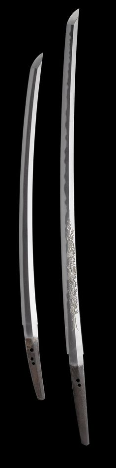 Think i've never seen a plum blossom & dragon mixed into 1 horimono before… a bit too 'busy' for my taste but it's a piece of art, that's for sure The very nice Koshirae of this daisho can be seen here. Samurai Sword Shop Info CenterUSA dave@samurai-sword-shop.com00