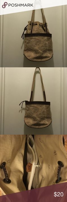 """Made in France Canvas Bucket Purse Made in France, """"washed"""" khaki canvas with brown leather trim (faux) small bucket/tote type of purse. Zipped pocked outside and  zipped divider inside. Oval. Bottom measures 6.5"""" x 9.5"""", 15"""" tall unfolded, 10"""" tall if folded. Bronze tone hardware. Will compliment boho or urban outfit. Easy to clean vinyl interior, with brand-name print. Excellent used condition. Texier Bags Totes"""
