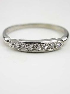 antique - i likey (finding a non-diamond or vintage wedding band i like is proving difficult :P)