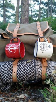 Best way to prepare a backpacking trip. Good mugs, warm blanket, backpack with lots of straps. Ready for an adventure!
