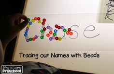 Using the light table to practice writing our first names |Play to Learn Preschool|