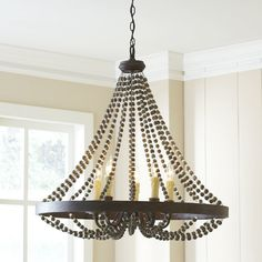 Complete your rustic dining room ensemble or cast a flickering glow over the foyer with this eye-catching chandelier, featuring a beaded design and candle-inspired fixtures. Dining Chandelier, Farmhouse Chandelier, Empire Chandelier, Rustic Chandelier, Beaded Chandelier, Dining Room Lighting, Chandelier Lighting, Chandeliers, Kitchen Lighting