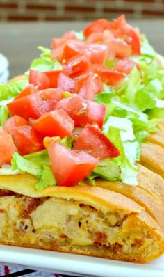 BLT Chicken Braid ~ Chicken, bacon, and cheese braided into a crescent roll and topped with lettuce and tomato