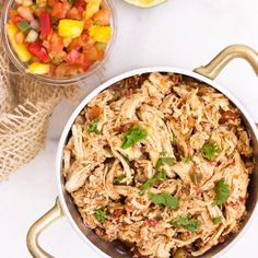Shredded Mexican Chicken, the perfect filling for burritos, tacos, quesadillas, chimichangas - anything goes!