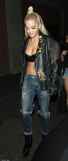 Rita Ora puts assets on show as she parties in a bra and ripped jeans #dailymail