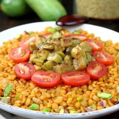 Whole grain bulgur, aromatic spices, and seared zucchini chunks are the core elements of this Middle Eastern-inspired Bulgur Wheat and Zucchini Bowl. Cilantro, Bulgur Salad, Couscous, Eggplant Salad, How To Cook Rice, Frijoles, Caramelized Onions, Bowl, Fried Rice