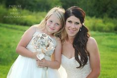 A picture that needs to be taken at every wedding, the Bride and the flower girl.