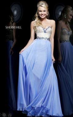 Beautiful two toned Sherri Hill gown. Long and flowing chiffon skirt and nude bodice featuring jeweled waistband and trimed sweetheart neckline. View Size Chart