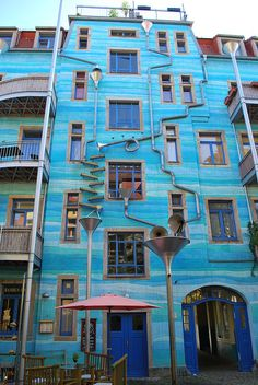 "Musical building: Neustadt Kunsth of passage. In Dresden, Germany. Rainwater collects at the top, flows down the pipes and funnels, and makes music. Well, not exactly ""music,"" but varied tones of splashing water."