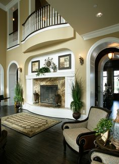 Love the details - inset fireplace, curved balcony, arched doorways etc.