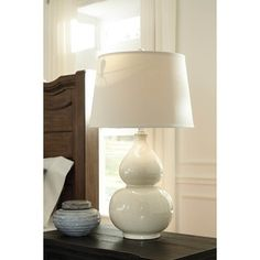Shop for Signature Design by Ashley Saffi Cream Ceramic Table Lamp. Get free shipping at Overstock.com - Your Online Home Decor Outlet Store! Get 5% in rewards with Club O!