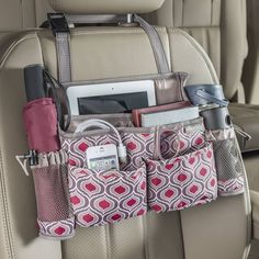 A car front seat organizer with 8 pockets for tablets, smartphones, water bottles, sanitizer and more. Grab the handle and swing it to become a back seat organizer for passenger access. High Road has the best selection of car organizers available. Car Seat Organizer, Car Organizers, Sew Organizer, Sewing Crafts, Sewing Projects, Sewing Ideas, Sewing Kit, Car Office, Car Essentials