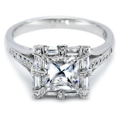 very pretty, unique prongs around the diamond! Beautiful ring, I think a cushion cut would be gorgeous