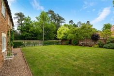 Garden laid to lawn, cottage for sale, for details, contact Winkworths, Bourne Exposed Brick Walls, Exposed Beams, Country Life, Country Living, Grey Painted Walls, Log Burning Stoves, Window Seat Storage, Multi Fuel Stove, Paved Patio