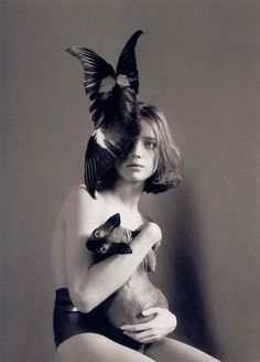 Natalia With Cat by Mert Alas & Marcus Piggott    Natalia Vodianova with an Alexander McQueen headpiece and a wrinkly, bald cat. By the ever impressive Mert & Marcus.