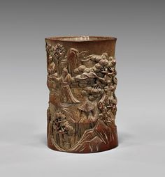 """Chinese Carved Bamboo Brushpot: Sages Chinese carved bamboo brushpot; of slightly squared, cylindrical form with continuous figural design of gatherings of sages amid rockery, palm and pine trees (some wear and use); H: 6"""""""