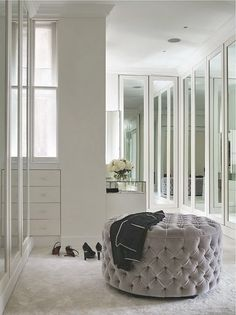 stunningly gorgeous mirrored dressing room/closet - tufted grey ottoman