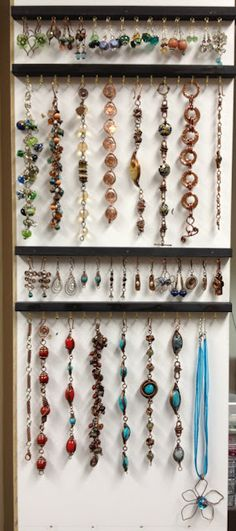 A simple but effective way to display or organize jewelry.  Make with old spoon rack from Gpa.