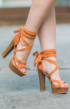 Cute orange lace-up sandals! Not sure I would wear them personally but they are definitely adorable. x