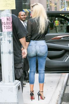 The backside: Bonelli had posted on Tuesday that the star was in NYC to promote her new denim line. It looked like the Keeping Up With The Kardashians cameras were also there