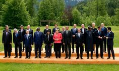 G7 leaders, leading industrial nations have agreed on tough measures to cut greenhouse gases by phasing out the use of fossil fuels by the end of the century, the German chancellor, Angela Merkel (pink jacket), has announced, in a move hailed as historic.