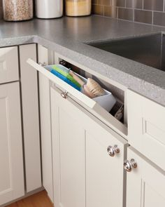 Don't forget to make use of even the smallest spaces to get the most out of your kitchen. a tilt-down drawer at your sink, for example, is a handy way to store sponges and knicknacks that would otherwise take up valuable counter space.Find more drawer solutions from the Martha Stewart Living collection at The Home Depot.