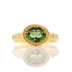 Brides.com: Green Engagement Rings Style 06209, 2.5ct green tsavorite with white diamonds in 18kt two tone gold, $16,950, Yael Designs  See more cushion-cut engagement rings.Photo: Courtesy of Yael Designs
