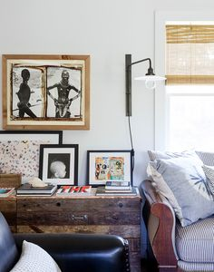 side table styling with a sconce, artwork and books | coco+kelley