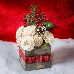 @curiouscountry posted to Instagram: Here's an idea of how to use beautiful wood (sola) flowers for a Christmas arrangement. These flowers are left their natural color and arranged with white-tipped pinecones and some faux berries and foliage in a sweet ribbon wrapped vintage box. A simple but stunning craft that also makes a great gift! Photo Credit: @heartandsola #christmas #naturaldecor #christmasdecor #winterdecor #holidays #holidaydecor #christmas2020 #christmastree #winter #christmaseve #