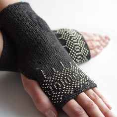 Very cozy merino wool and polyamide blend beaded fingerless gloves/wrist warmers in dark grey with shiny silver-like glass beads