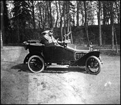 This photo shows that even the Tsarevitch Aleksey Nicholaevich would join in his father's passion for automobiles. Here Aleksey is driving his father in a fully functional child-size Peugot BeBe gasoline-powered car, designed by Ettore Bugatti for Peugot, given to the Tsarevich as a gift from his parents in 1913. This car would remain in the Alexander Palace after the Revolution.