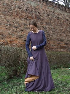 Female surcote, late medieval times, XIV cent. Surcote made of wool, with openings on the sides. Dress has contrasting linen lining. It has 4
