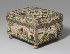 Cabinet with personifications of the Five Senses, third quarter of 17th century  English  Satin worked with silk and metal thread, purl, chenille, seed pearls, coral beads, and mica; tent knots, rococo, satin, couching, and detached buttonhole stitches, knots; woven metal thread trim; silk and paper lining  5 3/4 x 7 1/2 x 9 in. (14.6 x 19.1 x 22.9 cm)