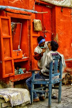 Street barber, India