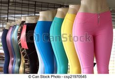A display of store dummies with different coloured pants.