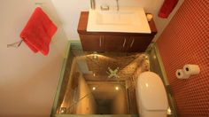 Bathroom in Guadalajara penthouse, built over elevator shaft with a see-through floor.