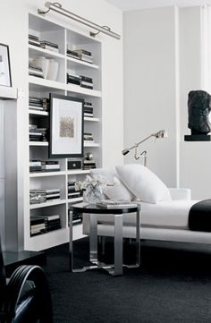 Ralph Lauren Home pairs minimalist decor with a sleek bookcase and lounge to create a modern living room atmosphere