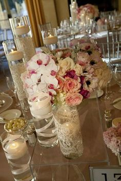 The lace and ribbon are pretty. Use some fake pearls along with river rocks in the floating candle jars.