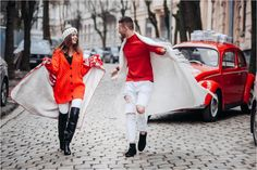 A guy and a girl in red sweaters run along the street of Lviv on the background of a retro car Retro Cars, Christmas Love, Red Sweaters, Love Story, Running, Guys, Street, Sneakers, Wedding