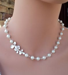 Pearl necklace with orchids