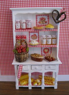 Apple Cottage Kitchen hutch dressed,  Twelfh scale dollhouse miniature. $38.50, via Etsy.